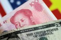 On Monday, the yuan was changing hands at 6.8502 per dollar, unexpectedly rising 0.28 per cent. Photo: Reuters