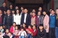 Exiled former Thai prime ministers Thaksin and Yingluck Shinawatra (middle row) visited their ancestors' home in Guangdong province on Saturday. Photo: Handout
