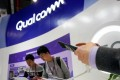 A Qualcomm sign is seen during the China International Import Expo (CIIE), at the National Exhibition and Convention Center in Shanghai, China November 7, 2018. Photo: Reuters/Aly Song