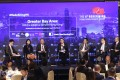 Post moderators Tony Cheung, Senior Political Reporter (left) and Yonden Lhatoo, Chief News Editor (right) with panellists Dr Yifan Hu, Regional Chief Investment Officer & Chief China Economist at UBS Global Wealth Management; Prof. Witman Hung, Principal Liaison Officer for Hong Kong at The Shenzhen Qianhai Authority; Albert Ng, Chairman of China and Managing Partner of Greater China at EY; Denis Ma, Head of Research for Hong Kong at JLL and Joseph Chan, Chairman of the Silk Road Economic Development Research Center speak at Greater Bay Area: Will the initiative benefit Hong Kong?