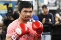 Manny Pacquiao poses at a boxing club in Los Angeles as he prepares for his WBA welterweight title fight against Adrien Broner. Photo: AP