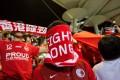 A Hong Kong fan covers his face during the Chinese national anthem before an international friendly soccer match between Hong Kong and Bahrain at Mong Kok Stadium. Photo: AFP