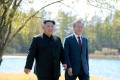 South Korean President Moon Jae-in and North Korean leader Kim Jong-un walk during a luncheon, in this photo released by North Korea's Korean Central News Agency (KCNA) on September 21, 2018. Photo: Reuters