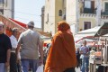 Bangladeshi market traders and customers in Balero Market, Palermo
