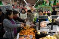 People buy vegetables and fruits at a supermarket in Beijing on November 30, 2018. Photo: AFP
