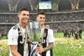 Juventus stars Cristiano Ronaldo (left) and Argentine forward Paulo Dybala celebrate with the Supercoppa trophy. Photo: EPA