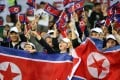 North Korea cheer during the Asian Cup match against Saudi Arabia. Photo: EPA
