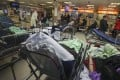 Temporary beds had to be laid along corridors or between fixed ones as Queen Elizabeth Hospital in Yau Ma Tei reached a bed occupancy rate of 119 per cent. Photo: Nora Tam