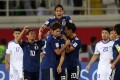 Japan players celebrate during their AFC Asian Cup group F win against Uzbekistan in the United Arab Emirates. Photo: Xinhua