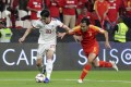 Feng Xiaoting (right of China vies with Sardar Azmoun of Iran during the AFC Asian Cup. Photo: Xinhua