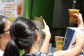 Customers take a picture with their Tiger Sugar bubble tea in Causeway Bay. Photo: Dickson Lee