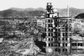 An August 8, 1945 photo of survivors walking past one of the few buildings still standing after the US nuclear attack on Hiroshima, Japan. Photo: AP