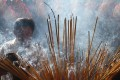 A man burns incense during Tet, the Vietnamese Lunar New Year celebration, in Ho Chi Minh City. Photo: Alamy