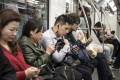 China's smartphone market, the world's largest, is valued at US$133.6 billion by some industry estimates. Photo: Bloomberg