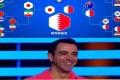 Xavi Hernandez stands in front of his AFC Asian Cup 2019 predictions. Photo: Twitter/@alkasschannel