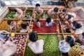 People enjoying a dip in a hotpot-shaped hot spring pool at a hotel in Hangzhou in China's Zhejiang province. Photo: AFP