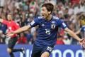 Japan's forward Yuya Osako celebrates a goal during the 2019 AFC Asian Cup semi-final against Iran. Photo: AFP