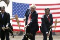 On June 28, 2018, President Donald Trump, center, along with Wisconsin Gov. Scott Walker, left, and Foxconn Chairman Terry Gou, participated in a groundbreaking event for the new Foxconn facility in Mt. Pleasant, Wisconsin. Photo: Associated Press