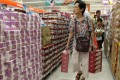 Hong Kong-listed Vinda International Holdings is the maker of China's bestselling brand of toilet paper. Residents shop at a supermarket in Yau Tong, Hong Kong. Photo: Edward Wong