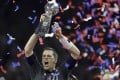 The New England Patriots' Tom Brady raises the Vince Lombardi Trophy after defeating the Atlanta Falcons in overtime in Super Bowl 51. Photo: AP