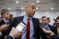 US Democratic Senator from New Jersey Cory Booker responds to a question from the news media in the subway of the US Capitol in Washington, DC. Photo: EPA-EFE