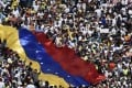 Opposition activists pour to the streets to back Venezuelan opposition leader Juan Guaido's calls for early elections, in Caracas. Photo: AFP