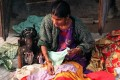 A woman sews clothes in New Delhi. File photo: AFP
