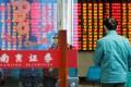A man enters a stock brokerage office of Nanjing Securities in Nanjing, Jiangsu province, China on January 21, 2019. Photo: Reuters