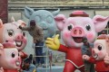 Men work on pig sculptures in preparation for the upcoming Lunar New Year of the Pig, in the Changping district of Beijing. Photo: Reuters