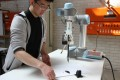 University of Sydney mechanical engineering student Wenzheng Zhang has programmed a robot that can produce a traditional Chinese ink painting, a style known as guóhuà.