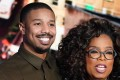 Actor Michael B. Jordan hugs Oprah Winfrey on stage during the taping of her TV show in which he discussed going into therapy after filming Black Panther. Photo: Reuters