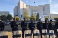Paramilitary soldiers stand guard outside the Supreme Court building in Islamabad. Photo: Reuters