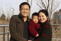 Wang Quanzhang (left) and his wife Li Wenzu pose for a photo with their son at a park in eastern China's Shandong province. Photo: AP