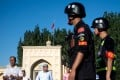 Police patrol outside the Id Kah Mosque in Kashgar, Xinjiang, after morning prayers. Photo: AFP