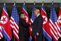 A June 12, 2018 photo of North Korean leader Kim Jong-un and US President Donald Trump on Sentosa Island in Singapore. Photo: AP