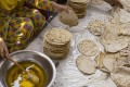 Ghee is added to chapattis at the Golden Temple in Amritsar, India. Photo: Alamy