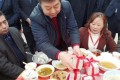 Tycoon Zheng Daqing hands over bundles of cash to the residents of the Sichuan village in which he was born. Photo: Thepaper.cn