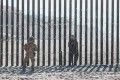 A US Border Patrol officer stands in front of the fence that divides the US and Mexico at Friendship Park in San Diego, California. File photo: AFP