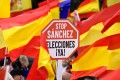 Right-wing protesters hold a sign calling for elections and reading 'Stop Sanchez' during a demonstration in Madrid against Spanish Prime Minister Pedro Sanchez, accusing him of making concessions to Catalan separatists. Photo: AFP