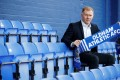 New Oldham Athletic manager Paul Scholes poses with a club scarf after the press conference. Photo: Reuters