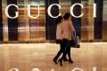 Shoppers walking past a Gucci shop in Nanjing, east China's Jiangsu province. Photo: AFP