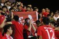 Hong Kong fans cover their faces and boo as the national anthem is played, at a friendly soccer match against a visiting Thailand team, on October 11, 2018. Felix Wong