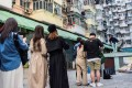People lining up to take a photo at a popular Instagram spot in a residential area in Quarry Bay, Hong Kong. Photo: AFP