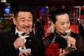 """Chinese actor Wang Jingchun (L), Silver bear for Best Actor in the film """"So Long, My Son"""" (Di Jiu Tian Chang) and Chinese actress Yong Mei, Silver Bear for best actress in the same film pose after the awards ceremony of the 69th Berlinale film festival on February 16, 2019 in Berlin. Photo: AFP"""