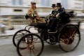 A Lutzmann vintage car made in 1896 makes its way down Whitehall  during a re-enactment of the first London to Brighton rally. This Lutzmann is believed to have taken part in the very first rally one hundred years ago. Photo: Reuters