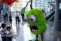 While traders ponder the way ahead for the toy industry as the US and China talk trade tariffs, two young visitors to the New York Toy Fair get on with the serious business of having fun. Photo: AFP