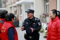 By July, every village and residential community in Beijing will have a community police officer doubling as its deputy party chief. Photo: Qianlong.com