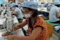 Vietnamese workers at a garment factory in Hanoi. Photo: AFP