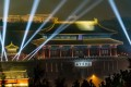 Lasers light up the Palace Museum and the night sky in Beijing. Photo: Xinhua
