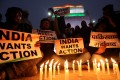 Demonstrators demand action at a candle light vigil held in India in the wake of the suicide bombing. Photo: Reuters
